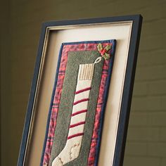Hang up a stocking—with or without a mantel—this holiday season by making  a fusible, framed treat.