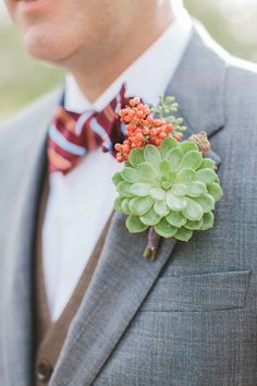Brides: A Green Succulent Boutonniere with Berries. A succulent boutonniere with red berries, created by Branch Design Studio. Boutonnieres, Succulent Boutonniere, Groom Boutonniere, Floral Wedding, Wedding Bouquets, Wedding Flowers, Wedding Corsages, Prom Corsage, Purple Wedding