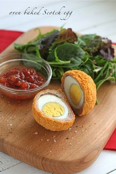 oven-baked-Scotch-egg .. Kinda freaky, but sounds kinda delicious, too.