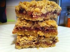 Raspberry Oat Bars made with Duncan Hines Classic Yellow Cake mix by The Cookie Crumbles.