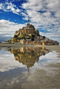 Mont Saint-Michel is a rocky tidal island and a commune in Normandy, France. It is located approximately one kilometre off the country's north-western coast, at the mouth of the Couesnon River near Avranches. Places Around The World, Oh The Places You'll Go, Places To Travel, Places To Visit, Western Coast, North Western, Le Mont St Michel, France Travel, World Heritage Sites