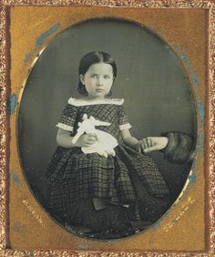 ca. 1850's, [daguerreotype portrait of a young girl holding a doll and an anonymous hand], Charles Evans