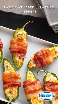 May your taste buds revel in victory with these Bacon-Wrapped Jalapeño Peppers. A great appetizer for the game day party. PHILADELPHIA Spicy Jalapeño Cream Cheese Spread and KRAFT Shredded Sharp Cheddar Cheese mixed together, then stuffed into jalapeño pepper halves. Which are then wrapped in OSCAR MAYER Bacon and cooked until the bacon is crispy. Victory is yours!