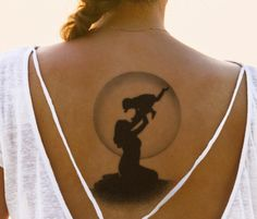 Mother-son-and-moon tattoo on back