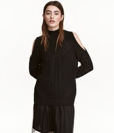 Black. Textured-knit sweater in a cotton blend. Small stand-up collar, long raglan sleeves with cut-out shoulders, and ribbing at cuffs and hem.
