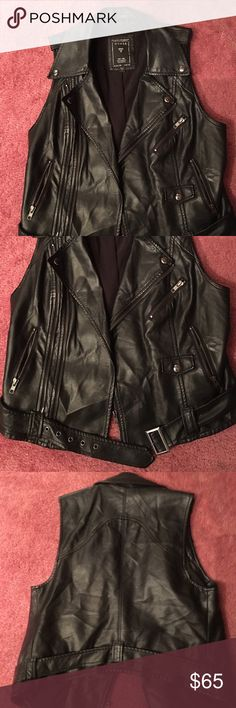 Faux leather Guess vest Gently used faux Leather Biker style Guess vest that I bought in Las Vegas. It can be worn a few different ways. The belt is removable and the zipper has two zip up options. The style is a bit oversized Guess Jackets & Coats Vests