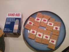 Bloody Band-Aids - Graham Crackers with Colored Frosting!