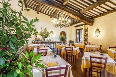 The restaurant and its hand made chandelier at Villa le Barone