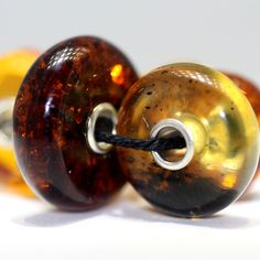 Natural Amber Trollbeads made with amber over 55 Million years old. Stunning.