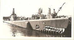 USS Redfin (SS-272) at Pearl Harbor in 1945; the colorful art would have to come off before they went to sea again