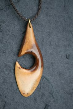 Pendant of Wild Olive wood on handmade cord. Measurements:  length - 60mm, Width - 23mm