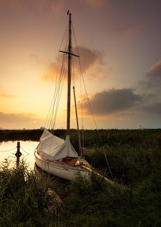 Moored boat at sunset / Located on the River thurne, Norfolk Broads, UK