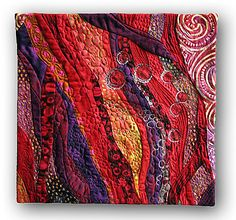 """Hilde Morin, TRIPLE BERRY JAM - 2009 12"""" x 12"""" random curve pieced, machine quilted, cotton lace inserts JUDGES' CHOICE 2010 Quilting Arts Calendar Contest Featured in August/September 2009 Quilting Arts magazine"""