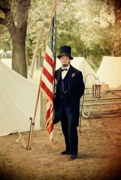 Ralph C. Lincoln (3rd cousin to Abraham) poses with flag