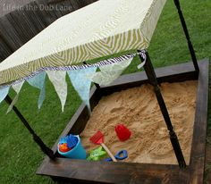 Life in the Dub Lane: Pottery Barn Inspired Sand Box DIY (Kind of looks like a upside down old table?) lol