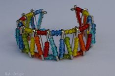 Rainbow Safety Pin Bracelet by allareunique Safety Pin Bracelet, Safety Pin Jewelry, Safety Pins, Bangle Bracelet, Bead Crafts, Jewelry Crafts, Safety Pin Crafts, Homemade Jewelry, Crafts For Girls