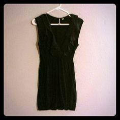 Black Sleeveless Dress Has alastic on the bust and bottom Robin K Dresses Midi