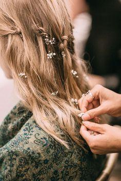 Baby blooms in wavy hair.