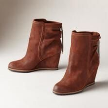 Our Ireland Short Wedge Boots are a striking fusion of comfort and style.