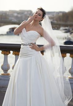 This is very similar to the dress I designed with the ladies over at Mrs. K and Company here in Claremore, OK. I've also designed a custom veil and can't find anything even remotely similar as a reference picture.
