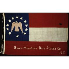 Flag of the Brown Mountain Boys  from west-central Stokes County. Part of the Second Battalion North Carolina Infantry, the Brown Mountain boys landed on Roanoke Island on the morning of February 8, 1862, just in time to become part of the Confederate surrender to Federal forces. The flag was taken and kept as a souvenir by a member of the Twenty-seventh Massachusetts until its purchase by the North Carolina Museum of History Associates, Inc. in 1987.