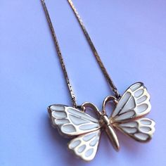 Gold and Cream Butterfly Necklace Spring is almost here! ☀️ The cream and gold are subtle...but this necklace is definitely a statement maker! Box chain...20 inches. Jewelry Necklaces