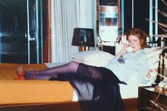 miss nicks lounging in heels with a wine glass.