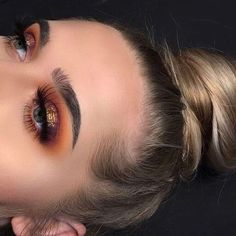 """Beautiful look @jahdefinitelyfeel BROWS: #Dipbrow in taupe, clear brow gel EYES: Modern Renaissance (love letter and realgar), violet, orange soda GLOW: So Hollywood Illuminator CONTOUR: ABH Stick Foundation in 'Mink"""" & """"Fawn"""" and 'Banana' GLOW: Sweets #GlowKit #anastasiabeverlyhills"""