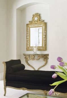 A Louis XVI-style daybed from The Antique & Artisan Center in Stamford, Connecticut, is covered in black velvet and offers a sophisticated spot for relaxing in the family room. The charming vignette also includes a gilded console from Melissa Levinson Antiques in Los Angeles and a mirror from Shabby Slips.  Style On Picture Lifestyle