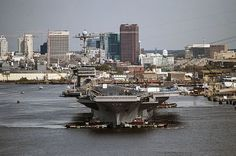 The aircraft carrier USS Harry S. Truman (CVN 75) transits the Elizabeth River en route to Norfolk Naval Shipyard.
