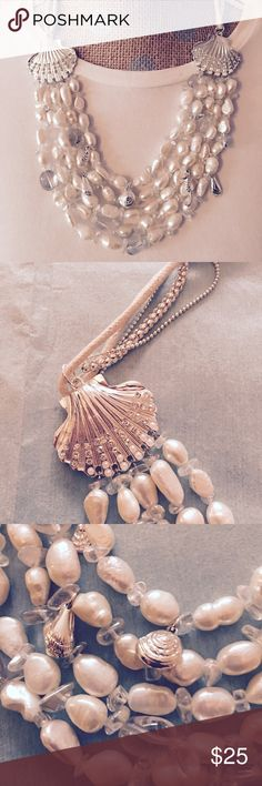 White Sands statement necklace NWOT. 5 strands of faux pearls with clear bead spacers. Silver sea life including clam shell, seahorse, conch shell dangles from strands. Ends of necklace feature silver tone shell with multi-rows of faux crystals beads, tiny faux pearls around edge. Super feminine and pretty. Jewelry Necklaces