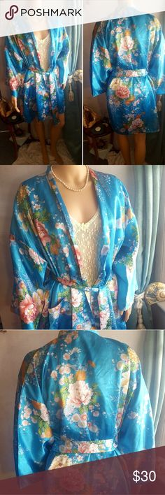 "☮HOST PICK Japanese Kimono Style Floral Turq Robe Vintage Japanese Kimono Style Floral Turq Robe 💙100% Polyester💙Made in Japan💙Beautiful turquoise color with large, all over floral pattern💙Comes with original belt although there are no belt loops on the garment and there is one front pocket on the lower right side💙 one size fits most 💙26.5"" wide and 35.5"" long💙 EUC 80s Vintage Robe 💐 I take great pride in my work and go over each item carefully 😍I can make mistakes but try my best…"