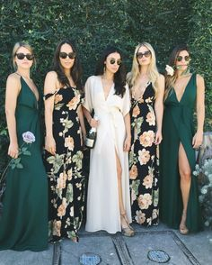 Weddings don't have to be boring. Love these floor length varied bridesmaid dresses//