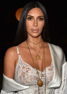 Kim Kardashian showed up to the Givenchy SS17 show in little more than sheer negligee on Sunday night, as she continued an insight into her lingerie draw at Paris Fashion Week in France.