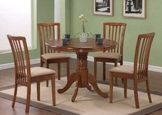 """5-Piece Dining Set in Oak - Coaster by Coaster Home Furnishings. $434.46. five piece set. dining room set. dining set. table and chair set. wood dining set. You will receive a total of 1 dining table and 4 side chairs. Table: 40"""" Diameter x 30""""H Chairs:18 1/2""""W x 21 3/8""""D x 35 5/8""""H Finish: Dark Oak Material: Rubberwood, Microfiber Fabric 5pc Pedestal Dining Table & Chairs Set Dark Oak Finish Table features round table top and single pedestal. Chair features beige microfiber upho..."""