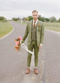 green suited groom