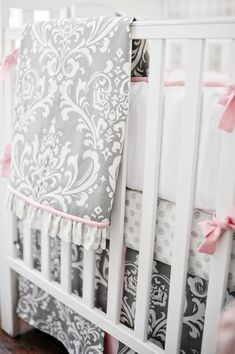 Gray and pink baby girl bedding. Only way I would do damask. White and black contrast too harsh
