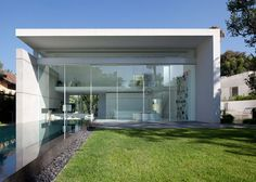 Double-height glass doors slide back to open up an entire facade of this house in Israel