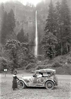 A highway scout car and passengers stop to take in the sight of Multnomah Falls, Oregon in 1918.