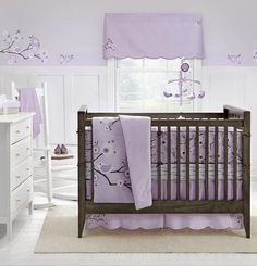 I think these colors are pretty for girl nursery - pale lavendar, white, and brown.