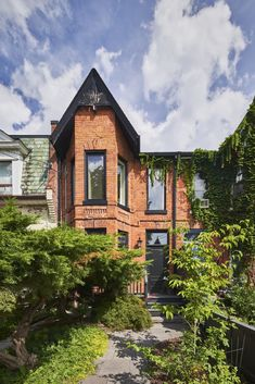 The modern extension in back belies the historic brick facade. #dwell #mullethomes #toronto #modernhometours