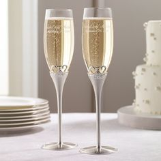 Wedding Toasting Flutes. $39.95 per pair - Two Hearts, One Love - Two hearts entwine to form one love, a sentiment these glass toasting flutes proclaim romantically in the brushed silver-plated design. From Exclusively Weddings.