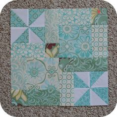 "This is a fun and easy block that measures 13"" {finished} and has lots of options to mix and match prints and solids.  I made mine out of leftover charm squares, but the size could easily be adjust..."