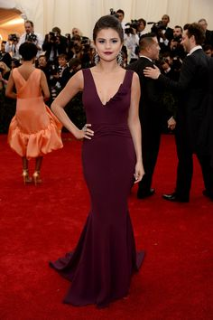 Selena Gomez represented DVF in the designer's plunging burgundy dress that she complemented with Lorraine Schwartz jewelry. #MetGala