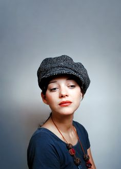 Marion, Marion in all forms: paperboy cap, woolly necklace and coral lips may look try-hard on someone else but not on her (save your generation)