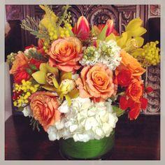 Flower arrangement featuring mimosa blooms.
