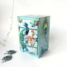 Peacock feather and flowers  aqua blue Mini wooden chest drawers,apothecary cabinet , Boho stile, romantic, green, blue,pink,aquamarine by Alenahandmade on Etsy https://www.etsy.com/listing/225094130/peacock-feather-and-flowers-aqua-blue