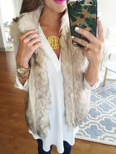 White tunic and faux fur vest for fall