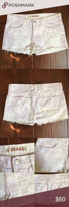 """J Brand Twisted Soft Lilac Cutoff Shorts These cutoff twisted lilac denim shorts feature 5-pocket styling & single-button closure. Wrinkling at front. Frayed bottom hem.  8.5"""" rise 