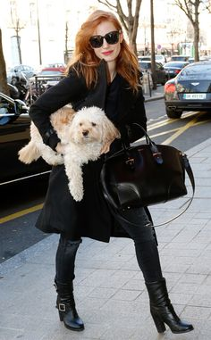 Jessica Chastain, flaunting chunky square sunnies, arrived in Paris for fashion week with her adorable furry pup in tow!